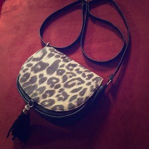 Claire's leopard cross body bag